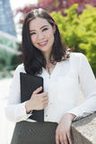 Smiling Young Asian Woman or Businesswoman Stock Photos