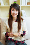 Smiling young asian woman Stock Photos