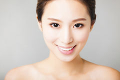 Smiling young  asian woman face Royalty Free Stock Images