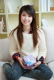 Smiling young asian woman with a gift box Stock Photography
