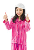 Smiling young Asian woman showing thumb up sign with both hands Stock Image