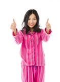 Smiling young Asian woman showing thumb up sign with both hands Royalty Free Stock Photo