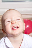 Smiling young baby girl Stock Photography