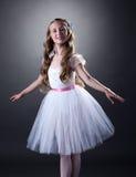 Smiling young ballerina posing at camera Royalty Free Stock Photo