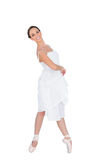 Smiling young ballet dancer standing on her tiptoes Stock Images