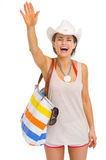 Smiling young beach woman in hat greeting Stock Photo