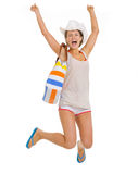Smiling young beach woman in hat jumping Stock Photos