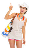 Smiling beach woman in hat pointing on copy space Stock Photography