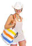 Smiling beach woman with hat pulled over eyes Stock Photography