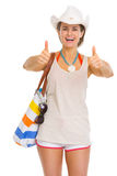 Smiling young beach woman in hat showing thumbs up Royalty Free Stock Image