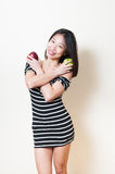 Smiling young beautiful asian woman shows two apples white backg Stock Photography