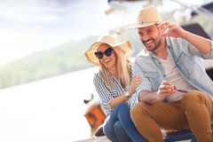 Smiling couple with straw hats stock image