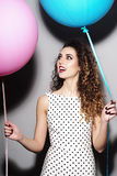 Smiling young beautiful girl with balloons Stock Photos