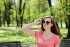 Smiling young beautiful girl in green park with different emotio. Ns, positive looking up Royalty Free Stock Photography