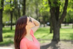 Smiling young beautiful girl in green park with different emotio. Ns, positive looking up Royalty Free Stock Photos