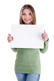 Smiling young beautiful girl holding white board Royalty Free Stock Photography