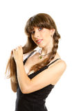 Smiling young beautiful woman. Holding her long braid Royalty Free Stock Photo
