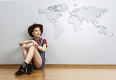Smiling young beautiful woman sitting on the floor. Mixed media stock photos