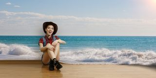 Smiling young beautiful woman sitting on the floor. Mixed media stock images