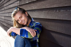 Smiling young beautiful woman sitting outside Stock Photography