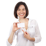 Smiling young beauty showing a white business card Royalty Free Stock Photo