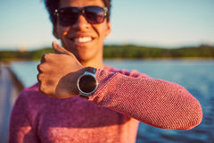 Smiling young black boy wearing trendy smart watch. stock photo