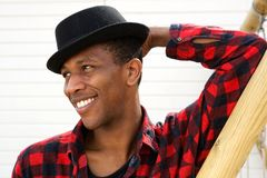 Smiling young black man with hat Stock Images
