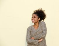 Smiling young black woman with arms crossed Stock Images