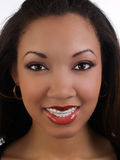 Smiling young black woman with braces upper teeth Stock Images
