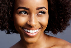 Smiling young black woman with curly hair looking away Royalty Free Stock Photo