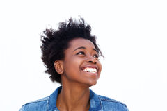Smiling young black woman looking away at copy space Stock Images