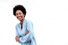 Smiling young black woman standing with her arms crossed Stock Photography