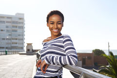 Smiling young black woman standing outside in summer Royalty Free Stock Images