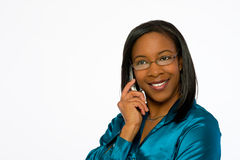 Smiling young black woman talking on mobile phone. Stock Photography