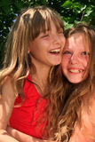 Smiling young blond girls Royalty Free Stock Image