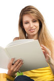 Smiling young blond woman with book Stock Image