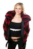 Smiling young blond woman in a fur jacket. Isolated on white Royalty Free Stock Photos