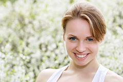 Smiling young blond woman Stock Photo