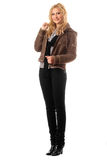 Smiling young blonde in a black pants Royalty Free Stock Photo