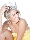 Smiling young blonde girl with silver crown Royalty Free Stock Photos