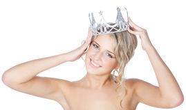 Smiling young blonde girl with silver crown Royalty Free Stock Images