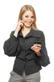 Smiling young blonde in a gray business suit Royalty Free Stock Photography