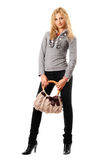 Smiling young blonde with a handbag Royalty Free Stock Photos