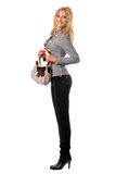 Smiling young blonde with a handbag. Isolated Royalty Free Stock Photos