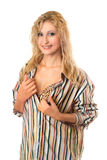 Smiling young blonde in a striped men's shirt Royalty Free Stock Image