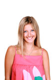 Smiling young blonde woman. Isolated portrait of a smiling young blonde woman royalty free stock photo