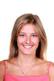 Smiling young blonde woman. Isolated portrait of a smiling young blonde woman royalty free stock images