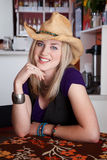 Smiling young blonde woman with cowboy hat Royalty Free Stock Photo