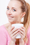 Smiling young blonde woman drinking coffee Stock Images