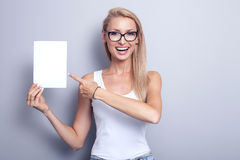 Smiling young blonde woman with empty card. Stock Photography